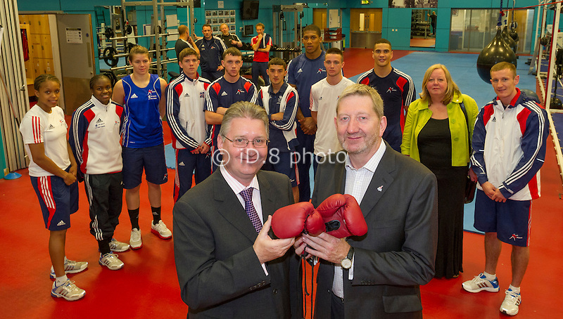 Len McCluskey Unite Union presents Derek Mapp Chairman at British Amateur Boxing Association Limited with a pair of boxing gloves signed by Mohammad Ali with the Olympic Boxing Squad plus Karen Reay