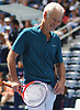 John McEnroe laughs during an exhibition doubles match at the newly-reopened Louis Armstrong Stadium in Corona, NY on Wednesday, Aug. 22, 2018. The 14,000 seat stadium which features a retractable roof will host US Open matches starting Monday, Aug. 27.
