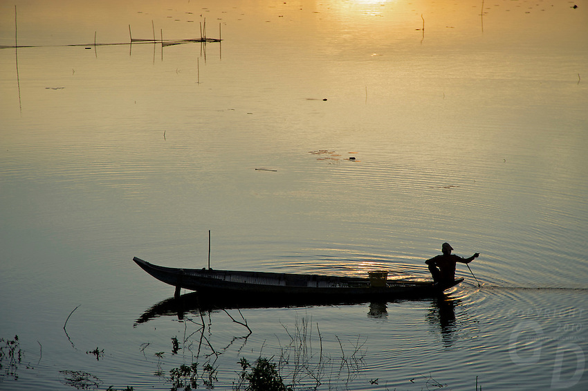 Life on and around the Tonle Sap Lake Cambodia Sunset and a lone fisherman