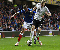 Kal Naismith holding on to Kevin Holt in the Rangers v Queen of the South Quarter Final match in the Ramsdens Cup played at Ibrox Stadium, Glasgow on 18.9.12.