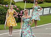 10th September 2017, Goodwood Estate, Chichester, England; Goodwood Revival Race Meeting; Grid Girls make their way off the race track for race start