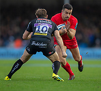 Saracens' Alex Lozowski is tackled by Exeter Chiefs' Gareth Steenson<br /> <br /> Photographer Bob Bradford/CameraSport<br /> <br /> Gallagher Premiership Round 10 - Exeter Chiefs v Saracens - Saturday 22nd December 2018 - Sandy Park - Exeter<br /> <br /> World Copyright &copy; 2018 CameraSport. All rights reserved. 43 Linden Ave. Countesthorpe. Leicester. England. LE8 5PG - Tel: +44 (0) 116 277 4147 - admin@camerasport.com - www.camerasport.com