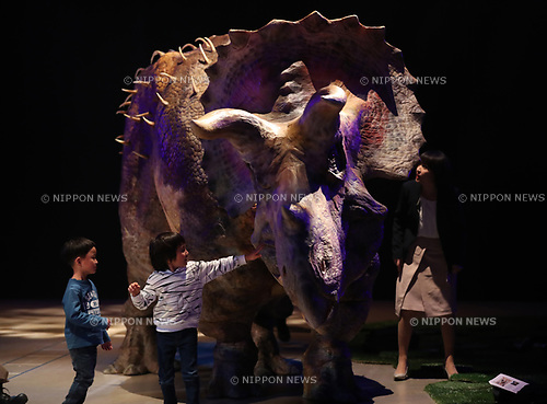 "April 25, 2017, Tokyo, Japan - A boy touches an actor wearing dinosaur-shaped mechanical suit ""dino-tronics"" at a dinosaur show ""Dino Safari"" at a press preview in Tokyo on Tuesday, April 25, 2017. A live show with six dinosaurs will be carried at Hikarie hall from April 26 through May 6.   (Photo by Yoshio Tsunoda/AFLO) LwX -ytd-"