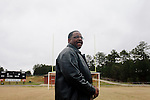 "The late Anthony ""Speedy"" Cannon's cousin Raymond Woodruff outside of Jacksonville High School in Jacksonville, Alabama."
