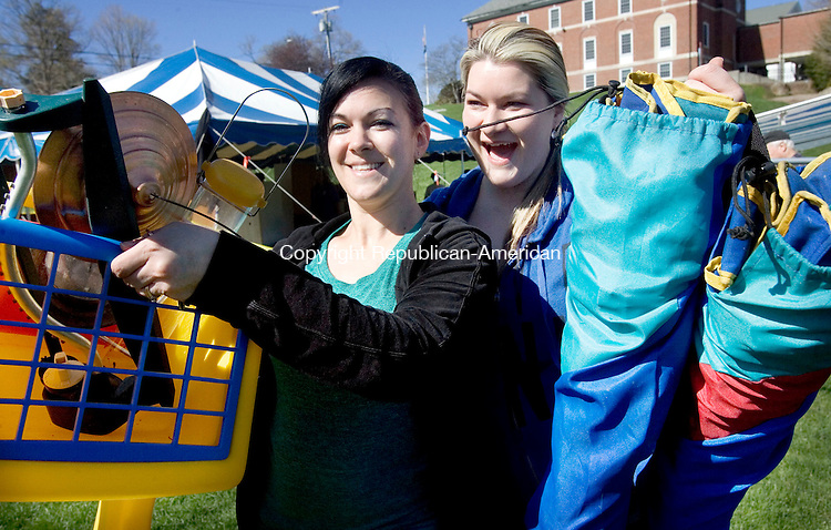 MIDDLEBURY CT. 02 May 2015-050215SV05-From left, Laura Davis and her sister Renee Steck both of Waterbury snag a pile of goods for their kids at the Middlebury Congregational Church tag sale and &quot;Old Fashioned Auction&quot; at the Shepardson Community Center in Middlebury Saturday. <br /> Steven Valenti Republican-American