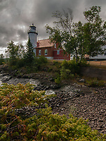 Storm clouds approach the Eagle Harbor shore and Lighthouse, Keweenaw County, Michigan