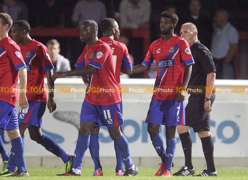 Medy Elito of Dagenham and Redbridge is congratulated after scoring the opening Daggers goal - Dagenham and Redbridge vs Colchester United at the London Borough of Barking and Dagenham Stadium - 03/09/13 - MANDATORY CREDIT: Dave Simpson/TGSPHOTO - Self billing applies where appropriate - 0845 094 6026 - contact@tgsphoto.co.uk - NO UNPAID USE