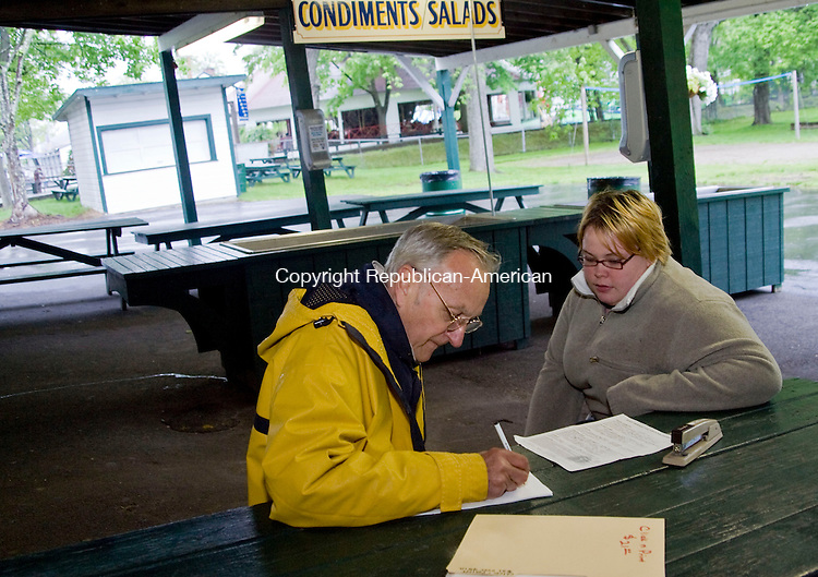 MIDDLEBURY, CT - 18 MAY 2010 -051810JT01-<br /> George Zonas, ride operations manager of Lake Quassapaug Amusement Park in Middlebury, interviews Lisa McManus, 20, of Naugatuck during a job fair for summer jobs at the park on Tuesday. <br /> Josalee Thrift Republican-American