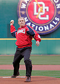 US President George W. Bush throws out the first pitch to during opening night for the Washington Nationals at RFK Stadium in Washington, DC Thursday 14 April 2005. The Nationals take the field tonight with a record of 5 wins 4 losses putting them in a tie for 1st place in their division.<br /> Credit: Shawn Thew / Pool via CNP