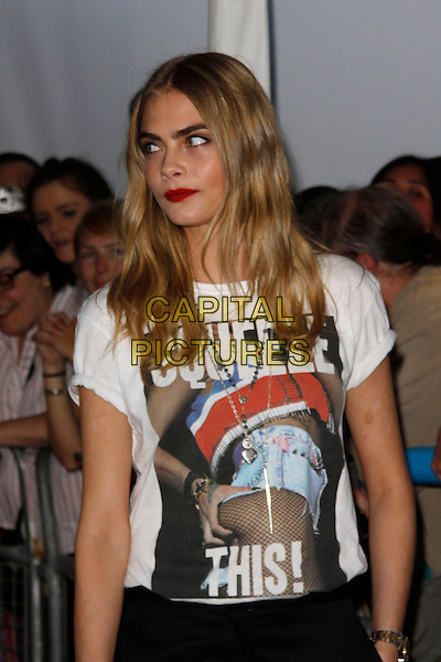 Cara Delevingne<br /> Glamour Women Of The Year Awards, Berkeley Square Gardens, London, England. <br /> 4th June, 2013<br /> half length white t-shirt print squeeze this black lipstick red    <br /> CAP/AH<br /> &copy;Adam Houghton/Capital Pictures