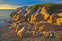 Rocky shoreline of Chedabucto Bay at sunset, Fox Island, Nova Scotia, Canada