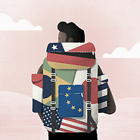 Young man wearing backpack with many different flags