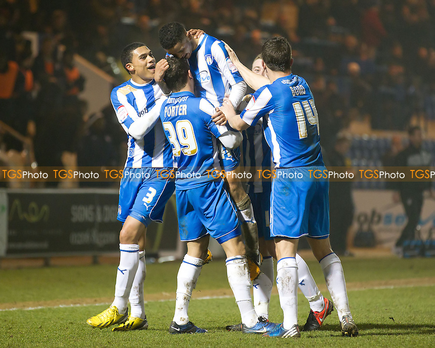 The Colchester players celebrate the opening goal from Billy Clifford - Colchester United vs Yeovil Town - NPower League One Football at the Weston Homes Community Stadium - 26/02/13 - MANDATORY CREDIT: Ray Lawrence/TGSPHOTO - Self billing applies where appropriate - 0845 094 6026 - contact@tgsphoto.co.uk - NO UNPAID USE.