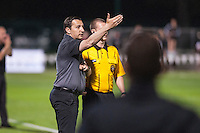 Kansas City, Mo. - Saturday April 23, 2016: FC Kansas City head coach Vlatko Andonovski argues with the fourth official during a match against Portland Thorns FC at Swope Soccer Village. The match ended in a 1-1 draw.