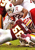 Washington Redskins linebacker LaVar Arrington (56) tackles Arizona Cardinal running back Michael Pittman (32) in first quarter action against the Arizona Cardinals in Landover, Maryland on January 6, 2002. The Redskins won the game 20 - 17.<br /> Credit: Ron Sachs / CNP