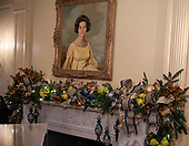 "The 2018 White House Christmas decorations, with the theme ""American Treasures"" which were personally selected by first lady Melania Trump, are previewed for the press in Washington, DC on Monday, November 26, 2018.  Portrait of former first lady Lady Bird Johnson in the Vermeil Room also showing the garland around the mantel. <br /> Credit: Ron Sachs / CNP"