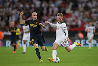 Christian Eriksen of Tottenham Hotspur crosses under pressure from Andrea Raggi of Monaco during the UEFA Champions League Group stage match between Tottenham Hotspur and Monaco at White Hart Lane, London, England on 14 September 2016. Photo by Andy Rowland.