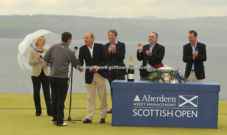 Roger Cornick, Chairman of Aberdeen Asset Management presents Jack McDonald with his salver for the leading amateur at The 2012 Aberdeen Asset Management Scottish Open. The event was staged over the links at Castle Stuart, Inverness, Scotland from 12th to 15th July 2012:  Stuart Adams www.golftourimages.com:15th July 2012
