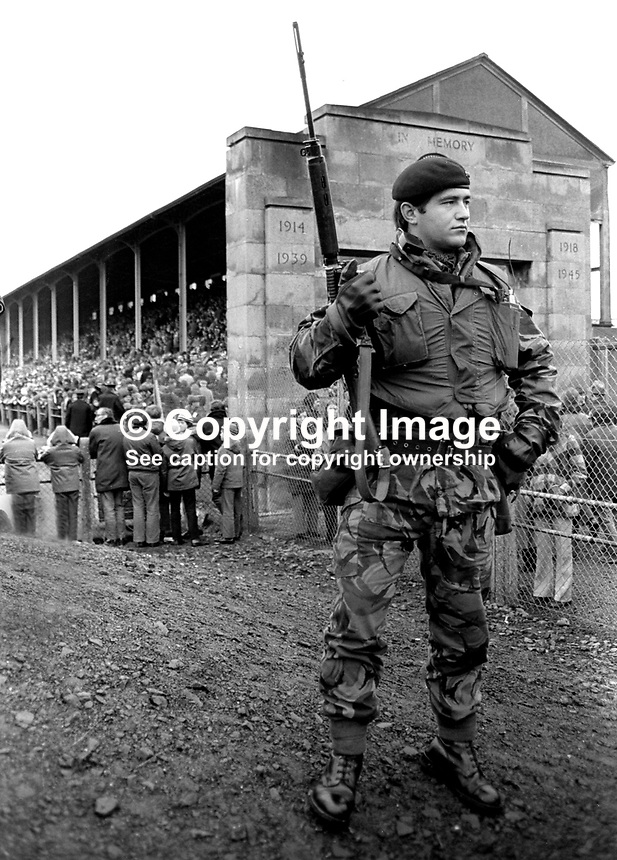 New Zealand All Blacks meet Ulster at Ravenhill, Belfast, N Ireland, 18th November 1972. The All Blacks won 16-9. The game was played at the height of The Troubles in N Ireland and security was very much in evidence.<br /> <br /> Soldier on duty on the terrace at Ravenhill. 197211180739e<br /> <br /> Copyright Image from Victor Patterson, 54 Dorchester Park, Belfast, UK, BT9 6RJ<br /> <br /> t1: +44 28 9066 1296 (from Rep of Ireland 048 9066 1296)<br /> t2: +44 28 9002 2446 (from Rep of Ireland 048 9002 2446)<br /> m: +44 7802 353836<br /> <br /> e1: victorpatterson@me.com<br /> e2: victorpatterson@gmail.com<br /> <br /> The use of my copyright images is subject to my Terms &amp; Conditions.<br /> <br /> It is IMPORTANT that you familiarise yourself with them. They are available on my website at www.victorpatterson.com.<br /> <br /> None of my copyright images may be used on a website unless they are visibly watermarked, i.e. &copy; Victor Patterson within the body of the visible image. Metadata denoting my copyright must NOT be deleted. <br /> <br /> Web use is extra at currently recommended NUJ rates.