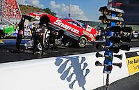 Jun. 15, 2012; Bristol, TN, USA: NHRA crew members for funny car driver Cruz Pedregon during qualifying for the Thunder Valley Nationals at Bristol Dragway. Mandatory Credit: Mark J. Rebilas-