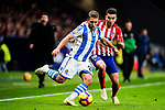 Kevin Rodrigues of Real Sociedad (L) in action against Angel Correa of Atletico de Madrid (R) during the La Liga 2018-19 match between Atletico de Madrid and Real Sociedad at Wanda Metropolitano on October 27 2018 in Madrid, Spain.  Photo by Diego Souto / Power Sport Images