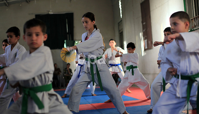 Palestinian children take part in a karate class, which aims at teaching self-defense techniques, at Gaza's sport club in Gaza City on June 02, 2013. Photo by Yasser Qudih