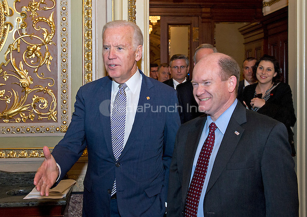 United States Vice President Joe Biden, left, departs the US Senate Chamber in the US Capitol in Washington, DC with US Senator Chris Coons (Democrat of Delaware), right, after being honored with a series of bipartisan tributes on the Senate floor on Wednesday, December 7, 2016.<br /> Credit: Ron Sachs / CNP /MediaPunch