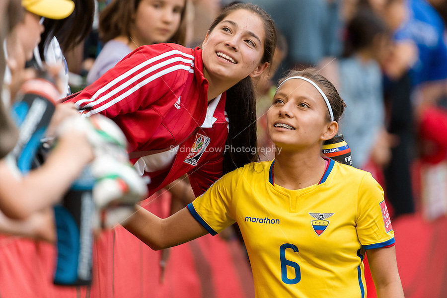 June 12, 2015: Angie PONCE of Ecuador meets fans after a Group C match at the FIFA Women's World Cup Canada 2015 between Switzerland and Ecuador at BC Place Stadium on 12 June 2015 in Vancouver, Canada. Switzerland won 10-1. Sydney Low/AsteriskImages