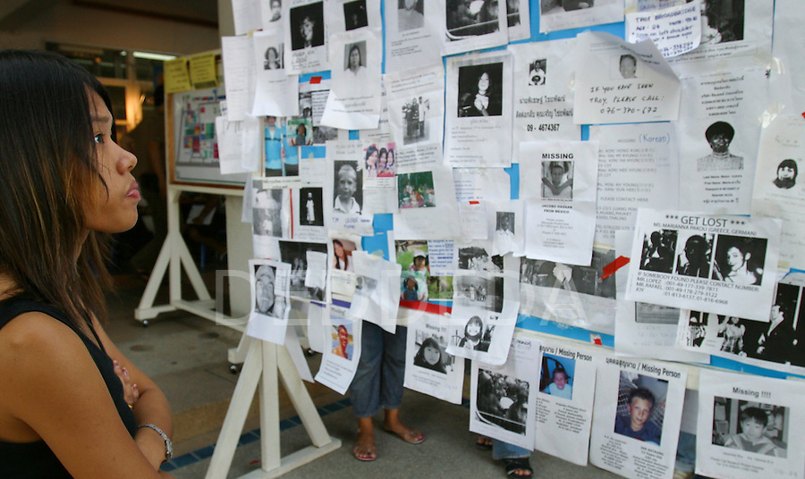 A woman looks at a notice board full of missing person postings on a bulletin board outside a local hospital, after Patong Beach was hit by tsunamis on Phuket Island, Thailand. On December 26, 2004, a major earthquake generated tsunamis that ravaged coastlines from Southeast Asia to Africa. Approximately 275,000 people were killed and tens of thousands were left homeless, making it one of the deadliest natural disasters in modern history.