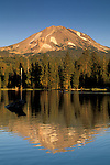 Mount Lassen volcano at sunset reflection in calm water of Manzanita Lake, Lassen Volcanic National Park, California