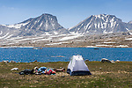 Tired backpackers and tent at French Lake during a backpacking trip in the High Sierra mountains outside of Bishop, CA, July, 2016.