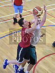Tina Cluskey and Reece McNally in action during the Golden Oldies basketball tournment in aid of Alzheimers Society held in St Mary's DS Gym. Photo:Colin Bell/pressphotos.ie