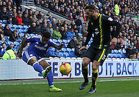Kadeem Harris of Cardiff City crosses the ball into the box past the challenging Mitchell Dijks of Norwich City during the Sky Bet Championship match between Cardiff City and Norwich City at Cardiff City Stadium, Wales, UK. Saturday, 04 February 2017