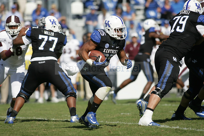 UK junior tailback Jonathan George runs the ball in the second half of the University of Kentucky football game vs. the Mississippi State Bulldogs at Commonwealth Stadium in Lexington, Ky., on Oct. 6, 2012. Mississippi State won 27-14. Photo by Becca Clemons | Staff