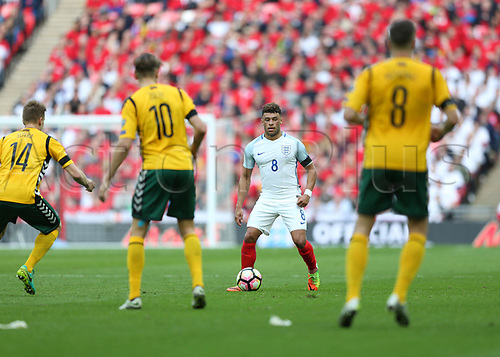 March 26th 2017, Wembley Stadium, London, England; World Cup 2018 Qualification football, England versus Lithuania; Alex Oxlade-Chamberlain of England looks to pass to a player while being marked by Arturas Zulpa, Egidijus Vaitkunas and Vykintas Slivka of Lithuania