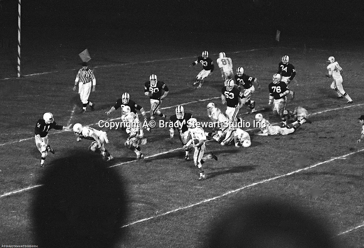 Bethel Park PA:  Offensive play with Mike Stewart scoring on an end run after great blocks from Dennis Franks 66 and Dan Hannigan 64.  Others in the photo; Gary Biro 81, Carl Kreisel 40, Don Troup 51, Bob Hensler 77,   The Bethel Park offense and defense played very well in the 16-0 shut out of the Upper St Clair Panters.  The defensive unit was one of the best in Bethel Park history only allowing a little over 7 points a game.  The 1970 team had more players winning 4-years scholarships than any other class. Division 1:  Dennis Franks (Michigan), Mike Stewart and Joe Barrett (William & Mary), Scott Streiner and Glenn Eisaman (Cincinnati), Division 2: Jim Dingeldine (West Liberty), Clark Miller (Clarion).