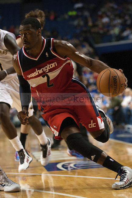 John Wall drives to the baseline during a NBA Preseason game between the Washington Wizards and the New Orleans Pelicans at Rupp Arena in Lexington, Ky., on Saturday, October 19, 2013. Photo by Michael Reaves | Staff