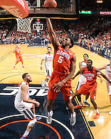 Clemson forward Jaron Blossomgame (5) shoot over Virginia forward Isaiah Wilkins (21) during an ACC basketball game Tuesday Jan. 19, 2016, in Charlottesville, Va. Virginia  defeated Clemson  69-62. (Photo/Andrew Shurtleff)