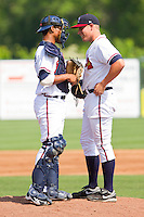 Catcher Christian Bethancourt #27 of the Rome Braves chats with his pitcher Tyler Hess #12 during the game against the Hagerstown Suns at State Mutual Stadium on May 2, 2011 in Rome, Georgia.   Photo by Brian Westerholt / Four Seam Images