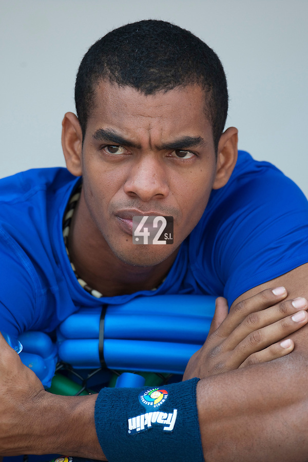 27 September 2009: Hector Olivera of Cuba is seen in the dugout prior to the 2009 Baseball World Cup gold medal game won 10-5 by Team USA over Cuba, in Nettuno, Italy.