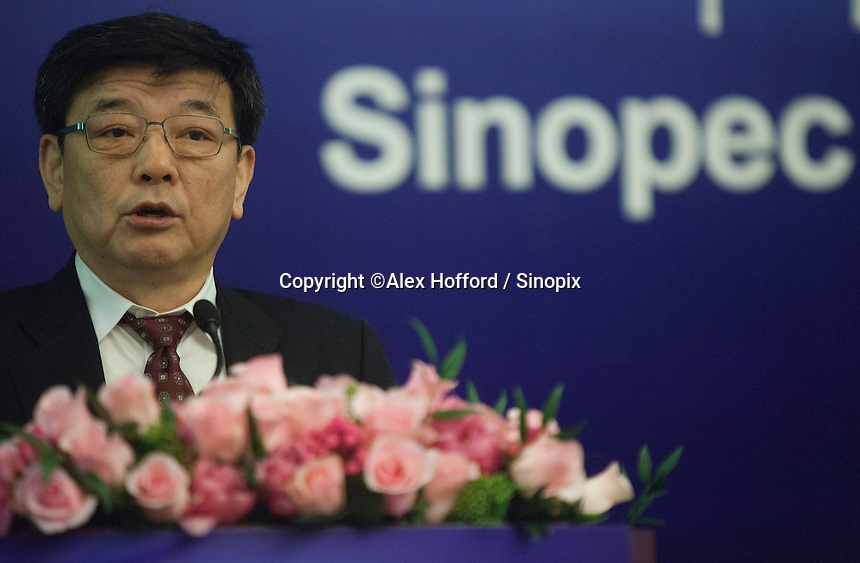 "China Petroleum & Chemical Corporation (Sinopec) President Li Chunguang is seen at a press conference to announce the company's annual financial results for the year ended 31 December 2013, Hong Kong, China, 24 March 2014. Sinopec, China's largest upstream refiner of oil and natural gas, announced that profits rose in 2013. The company said it recorded steady growth in 2013 despite sluggishness in the domestic and global economies. The company announced a profit attributable to equity shareholders of the company was CNY 66.1 billion (Euro 7.74 billion), up 3.5% year-on-year, with revenue up 3.4 per cent thanks to ""stable"" domestic demand."