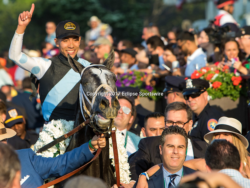 ELMONT, NY - JUNE 10: Jose Ortiz, aboard Tapwrit #2, holds a finger up as he is led to the winner's circle after winning the 149th Belmont Stakes on Belmont Stakes Day at Belmont Park on June 10, 2017 in Elmont, New York (Photo by Sue Kawczynski/Eclipse Sportswire/Getty Images)