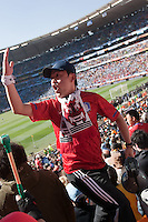 A South Korea fans leads other supporters in cheers for the South Korea team at  Soccer City in Johannesburg, South Africa on Thursday, June 17, 2010 during Argentina's and South Korea FIFA World Cup first round match.