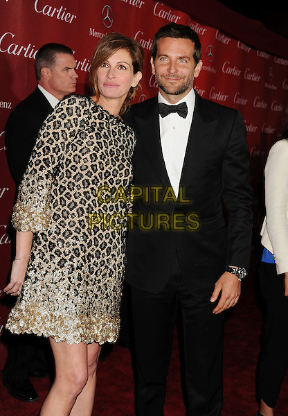 PALM SPRINGS, CA- JANUARY 04: Actress Julia Roberts (L) and actor Bradley Cooper arrive at the 25th Annual Palm Springs International Film Festival Awards Gala at Palm Springs Convention Center on January 4, 2014 in Palm Springs, California.<br /> CAP/ROT/TM<br /> &copy;Tony Michaels/Roth Stock/Capital Pictures