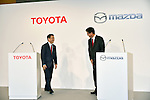 May 13, 2015, Tokyo, Japan - Presidents Akio Toyoda, left, of Toyota Motor Corp., walks up to Masamichi Kogai of Mazda Motor Corp. during a news conference at a Tokyo hotel on Wednesday, May 13, 20-15. Japans two automakers announced long-term partnership in technology in which Toyota will provide its fuel cell and plug-in hybrid technology in return for Mazda's proprietary Skyactive green technology. (Photo by Natsuki Sakai/AFLO)