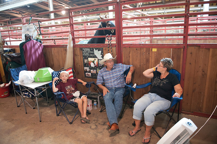 UNITED STATES - AUGUST 12:  Tom and Darlene Smith of Mitchellville, Iowa, and their grandsonAJ Larsen, hang out with their horse Charlee before a competition at the Iowa State Fair in Des Moines, Iowa.  (Photo By Tom Williams/Roll Call)