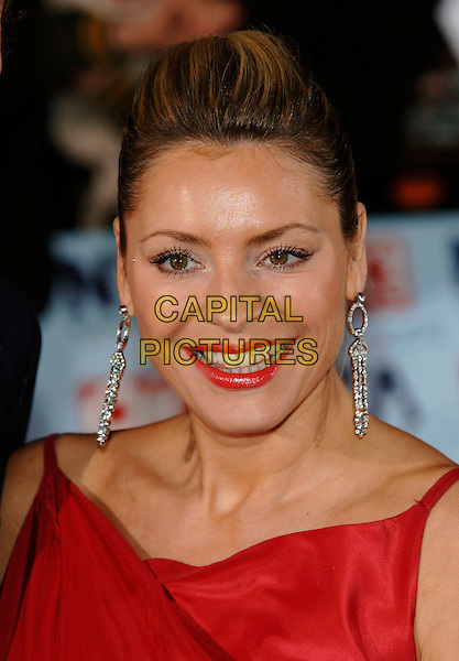 TESS DALY.The National Television Awards 2006 held at the Royal Albert Hall, London, UK. - Arrivals.October 31st, 2006.Ref: PL.headshot portrait red lipstick earrings Daley.www.capitalpictures.com.sales@capitalpictures.com.©Phil Loftus/Capital Pictures