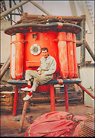 BNPS.co.uk (01202 558833)<br /> Pic: PhilYeomans/BNPS<br /> <br /> Ray Ives Locker<br /> <br /> Ray in the North Sea in the early seventies.<br /> <br /> Old man of the sea Ray Ives has opened his very own Davy Jones' locker of hundreds of nautical treasures he has salvaged from the seabed.<br /> <br /> Ray(77) has spent 40 years amassing a huge trove of historical artefacts that he has found during thousands of deep sea dives off the British coast.<br /> <br /> Ray's watery Aladdins cave includes canon balls, muskets, swords and even the bell from an ocean liner sunk by a German U-boat in the First World War.<br /> <br /> For years Ray had stuffed his collection into a tiny shed in the back garden of his home in Plymouth, Devon.<br /> <br /> But now the fascinating archive has now gone on display to the public in a ramshackle museum made from shipping containers.