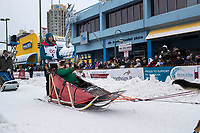 Shaynee Traska and team leave the ceremonial start line with an Iditarider and handler at 4th Avenue and D street in downtown Anchorage, Alaska on Saturday March 3rd during the 2018 Iditarod race. Photo ©2018 by Brendan Smith/SchultzPhoto.com