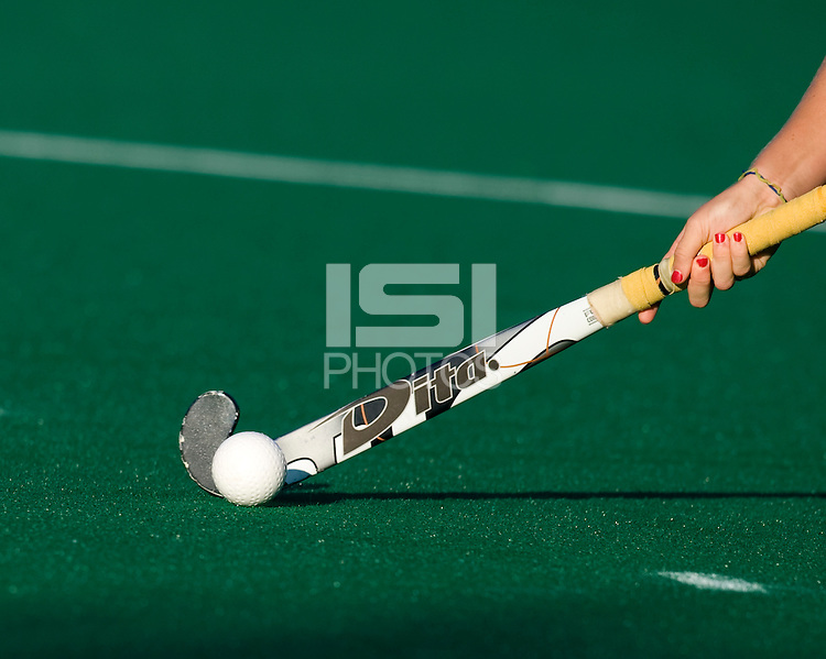 A player takes control of the ball during the NCAA Field Hockey Championship semfinals in College Park, MD.  North Carolina defeated Virginia, 4-3, in overtime.